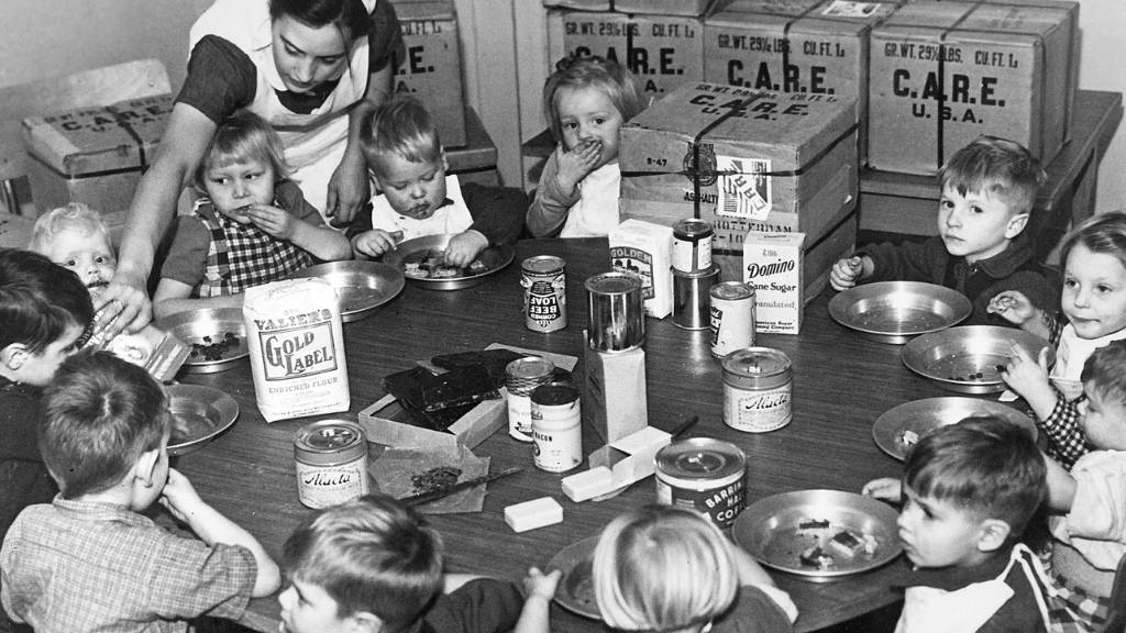 Children being fed from CARE packages after WW2
