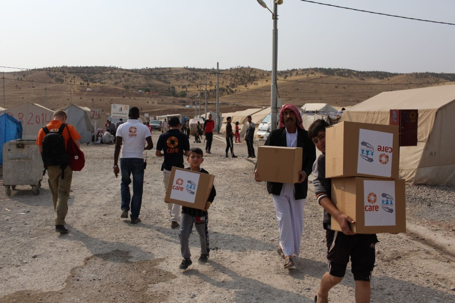 people carrying boxes of aid