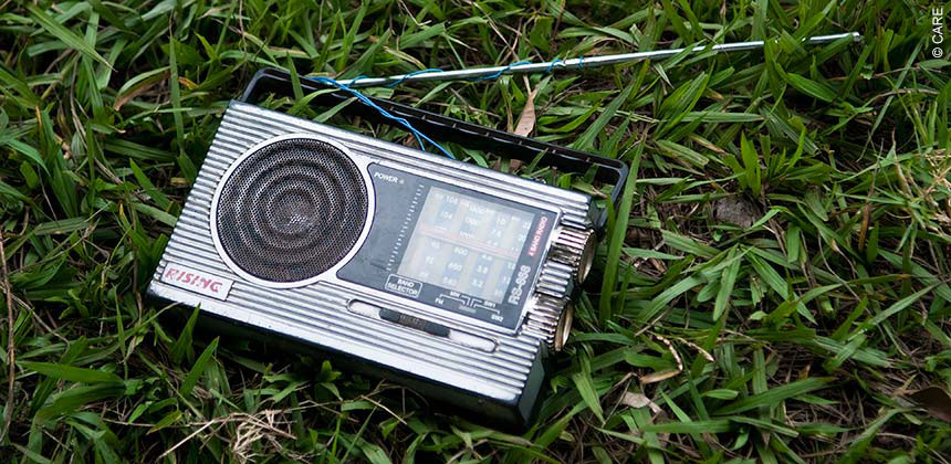 A radio lies on the grass