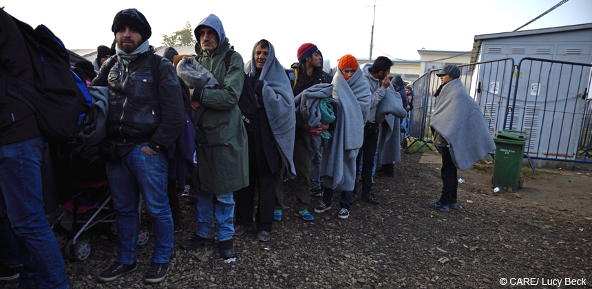 Refugees queue to board buses that will take them from Croatia on to Slovenia