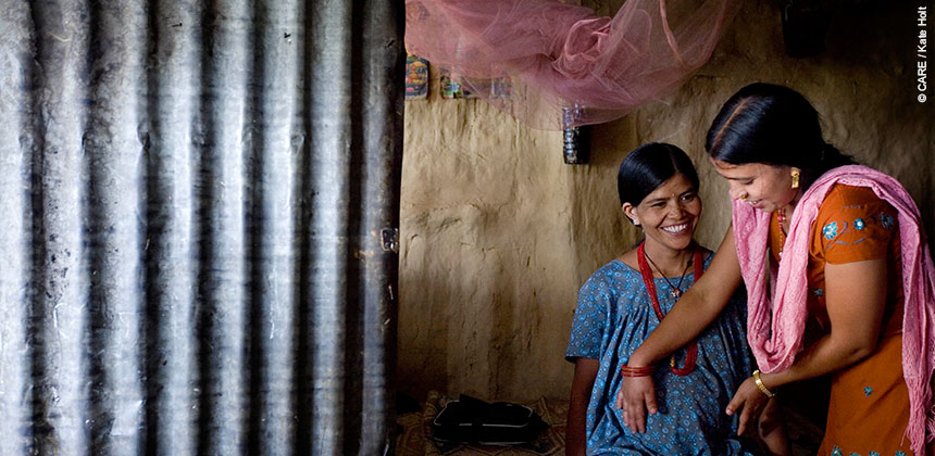 A mother to be is examined by a health worker trained by CARE. © CARE / Kate Holt.