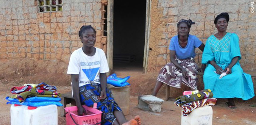Polou and family, after receiving relief supplies from CARE, provided by DfID