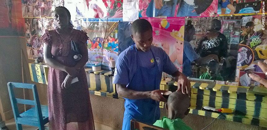 Uwimana Rose in the hairdressing salon she set up with a loan from the village savings and loan association