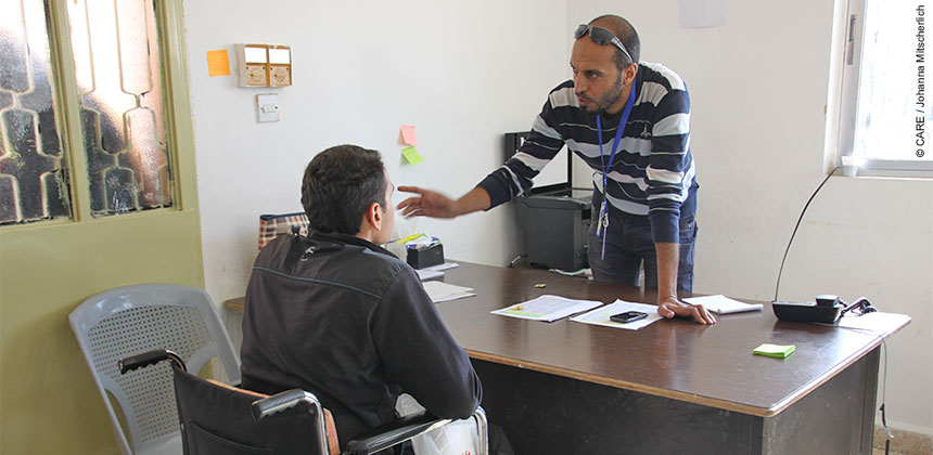 A refugee talking to a CARE advisor. In Lebanon and Jordan, CARE has already supported more than 120,000 particularly vulnerable people with cash assistance.