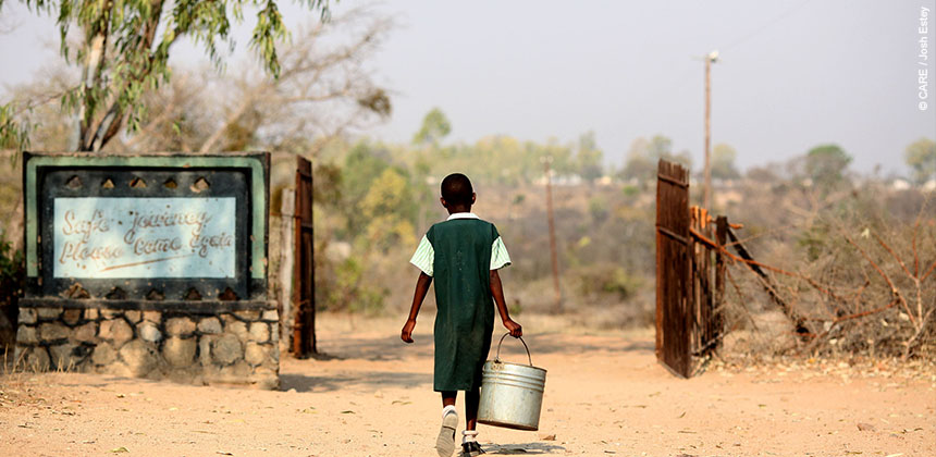 10 year old Agnes carries this 15 ltr bucket full of water every afternoon but is happy to only have to carry it 400 metres and be able to collect clean safe water. © CARE / Josh Estey