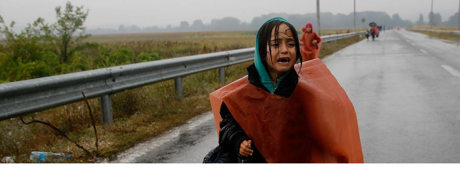 Crying girl on roadside