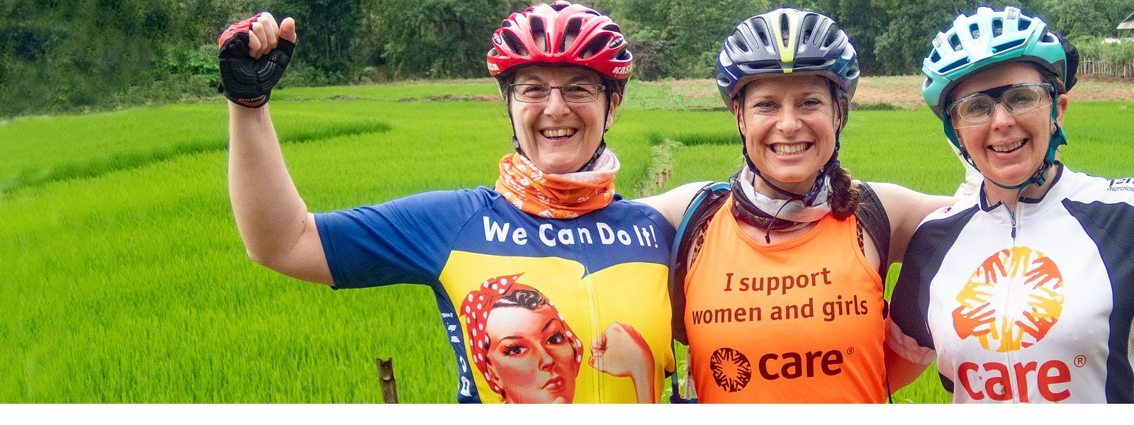 Three women cyclists on CARE Vietnam-Cambodia bike ride