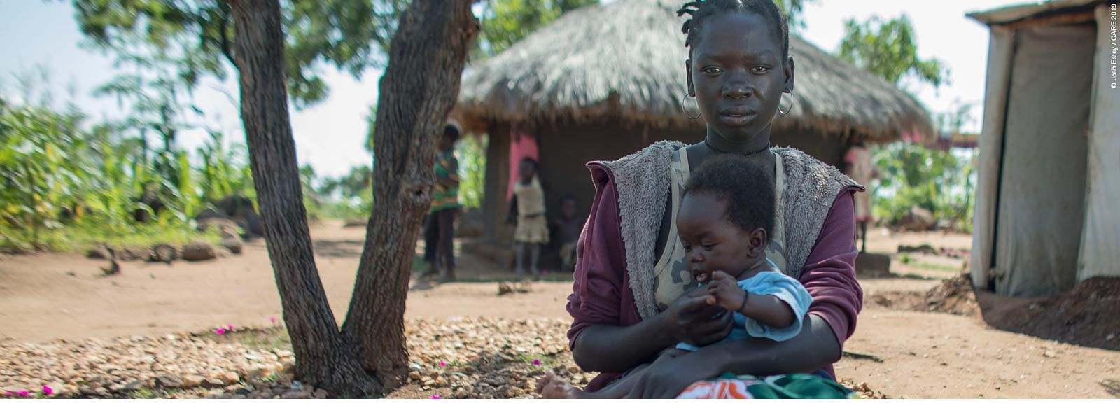 Grace and her baby in refugee camp, Uganda