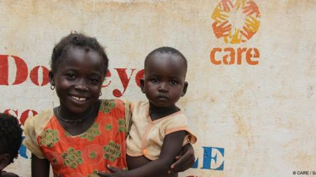 Children in front of a CARE sign in Chad