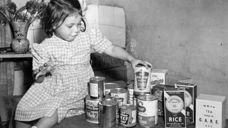A boy in Ethiopia washing his face with soapy water