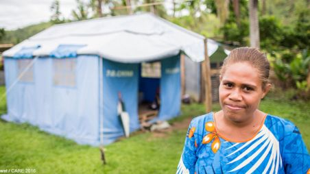 Woman outside temporary shelter in Fiji
