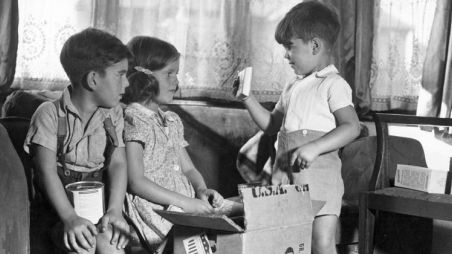Children opening a CARE package