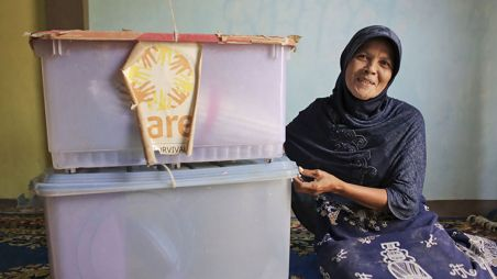 Ernawati from Indonesia with the family survival kit she received from CARE after the Indian Ocean tsunami
