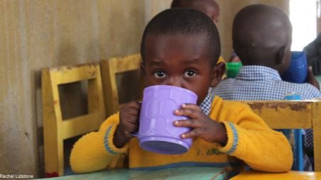 A boy drinking porridge