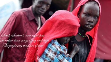 A girl carrying a young child at Bentiu camp in South Sudan