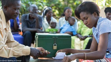 A meeting of a village savings group in Uganda