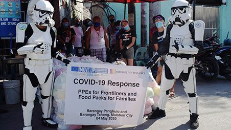People in Star Wars costumes at distribution of PPE kits