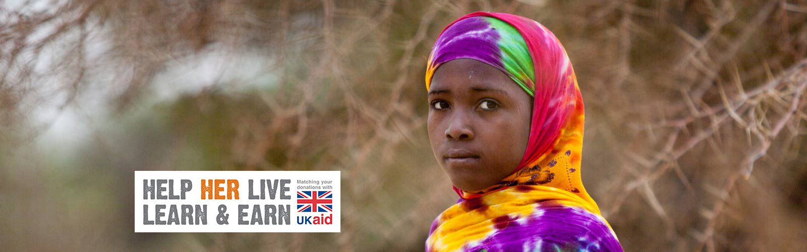 A girl from Chad. Text reads: Help Her Live, Learn and Earn. Matching your donations with UKAID.
