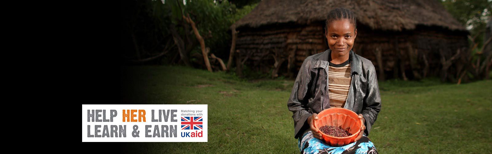 A smiling Ethiopian woman holds a bowl. Text reads: Help Her Live, Learn and Earn. Matching your donations with UKAID.