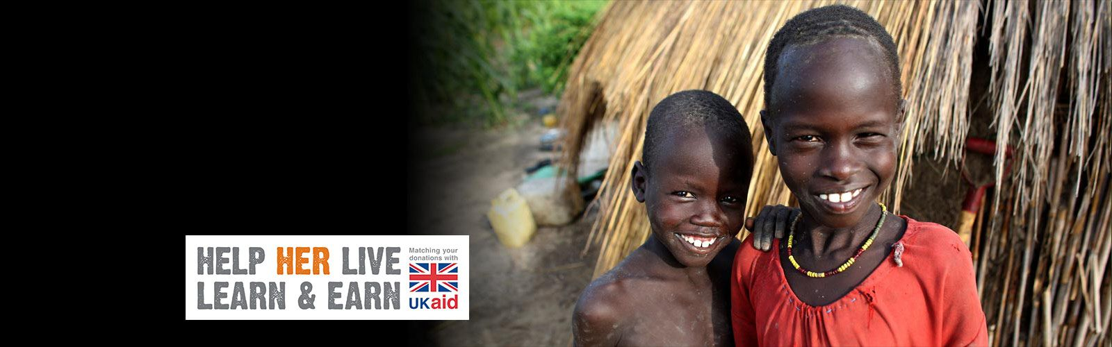 Two smiling South Sudanese children. Text reads: Help Her Live, Learn and Earn. Matching your donations with UKAID.