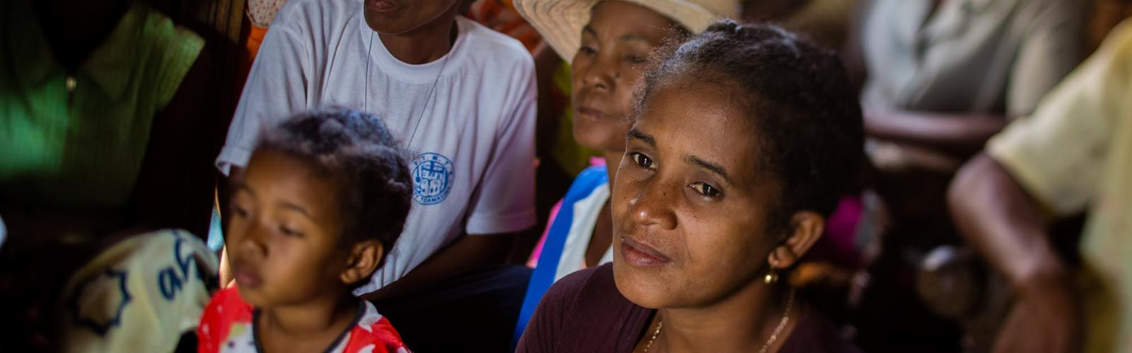 A woman in Madagascar at a community meeting