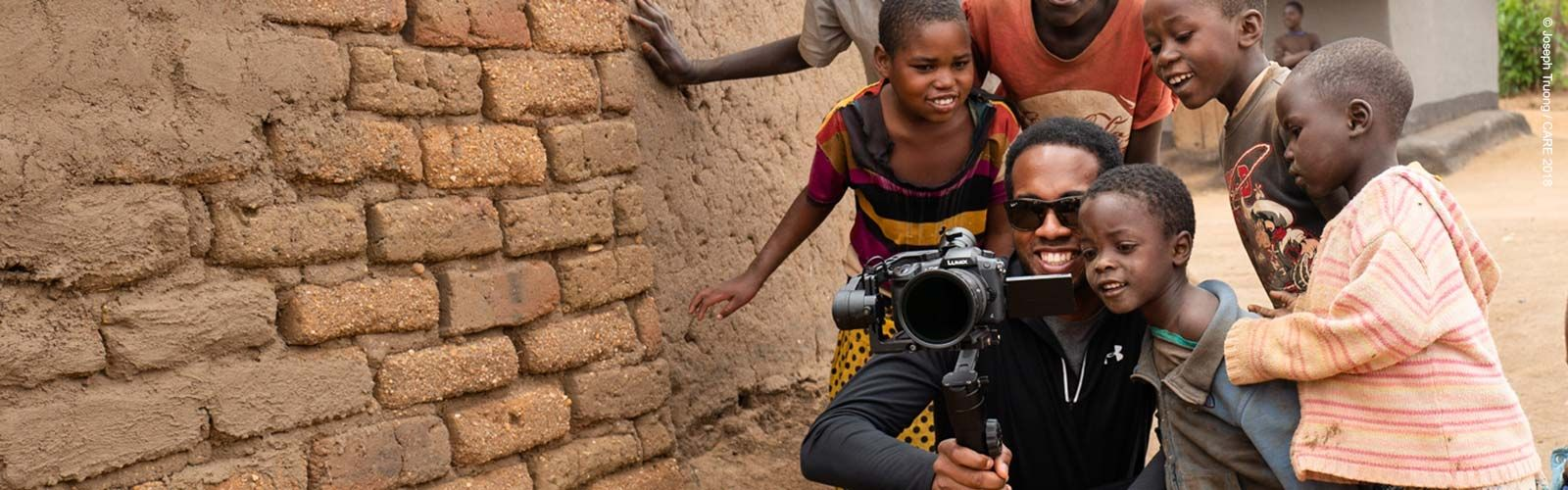 Group of children looking at video camera in Malawi