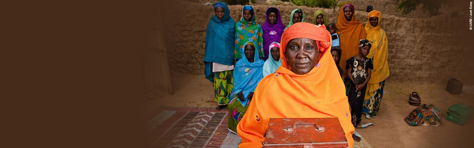 Kanai Garba holds her MMD group's savings box in Niger, 2010