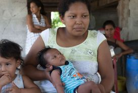 A mother in Ecuador with her one-month-old baby