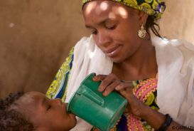 A woman feeding a child in Niger