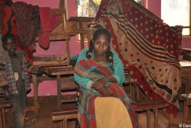 A woman and child in Ethiopia in a classroom used as emergency shelter