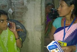Pregnant woman and health worker in Bihar