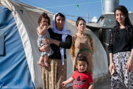A family at a camp for displaced people in Iraq