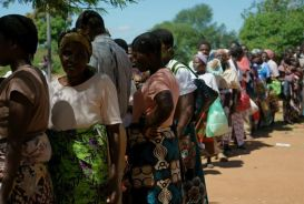 People queuing for food aid