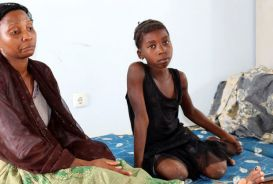 Afia Raphael and her daughter in a temporary shelter after Cyclone Kenneth