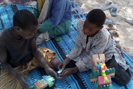 Children playing at a refugee centre in Niger