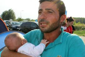 A Syrian refugee and his baby in Serbia