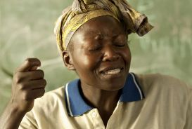 Muny speaking about the sadness and death Ebola has caused in her village in Sierra Leone