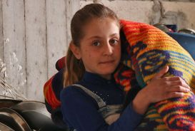 Syrian girl with blanket
