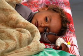 young boy recovering in hospital bed in Yemen
