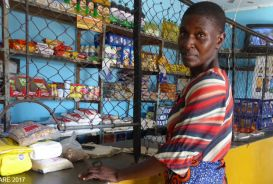 Letwin Chisorochengwe at the counter of a local shop in Zimbabwe