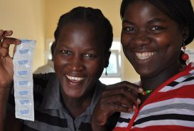 Matilde Alfiado and a friend at the Mais-Vida clinic. © CARE / Faith Amon