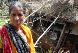 Jasodha outside the remains of what was once her house. It was destroyed in the cyclone. © CARE / Nigam