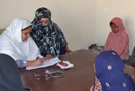 Women consult a female doctor from a mobile medical clinic. © CARE