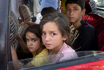 Children looking out of car window in Afghanistan