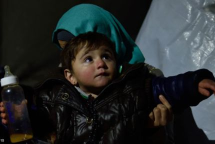 A young child at a refugee camp on the Serbia-Croatia border