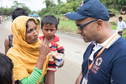 CARE staff talking to woman refugee