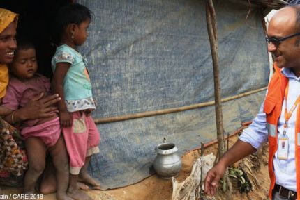 Zia Choudhury talks to woman at refugee camp
