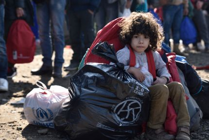 Five-year-old Noor from Syria waits with his family to board buses to take him from Croatia to Slovenia