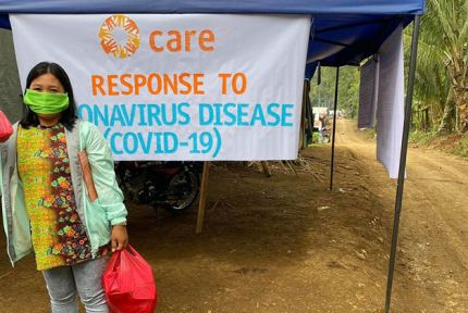 Woman with COVID-19 hygiene kits in the Philippines