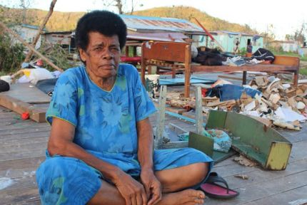 Eva Kata sits in what's left of her house in Kese village, Fiji